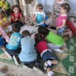 Children take part in a group drawing activity at a UNICEF-supported centre in Talbiseh. ©SARC/2013