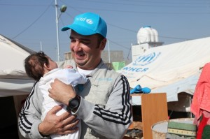UNICEF WASH Consultant Atheer Al Yasin with baby Jian, whom he helped deliver on the way to hospital in Sulimaniyah, northern Iraq. ©UNICEF/Iraq-2013/Niles
