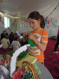 As well as drama, the child friendly space's activities include sewing and painting. © UNICEF/Jordan2014/Fricker.