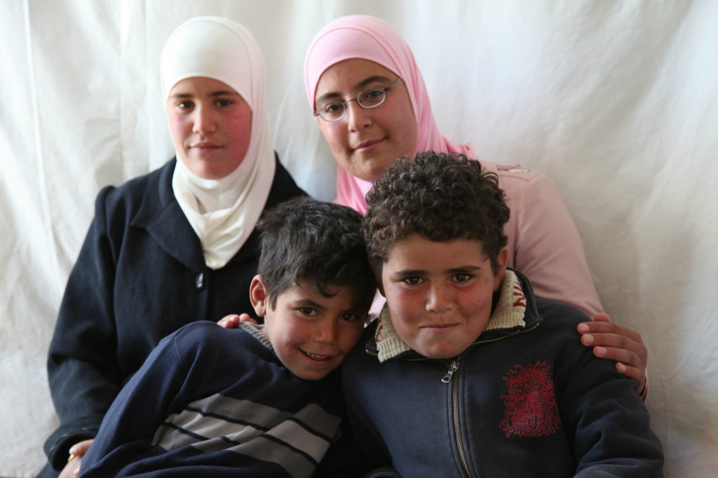 Ghada with three of her siblings in their caravan