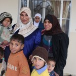 Oum Hani and her children queue for polio vaccines in Syria