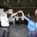 Children dance with Orlando Bloom during a graduation ceremony at the youth centre, which provides psychological support for children aged 11 to 18, as well as music, art, film-making and other activities.