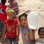 Displaced children feel the strain of fetching water in Aleppo