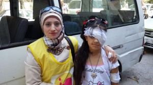 Judy (11) is recovering from head and eye surgery after being injured by shrapnel more than a year ago. Judy is supported by her mother Mazez (left) a public health worker. ©UNICEF/Syria-2014/Tiku.