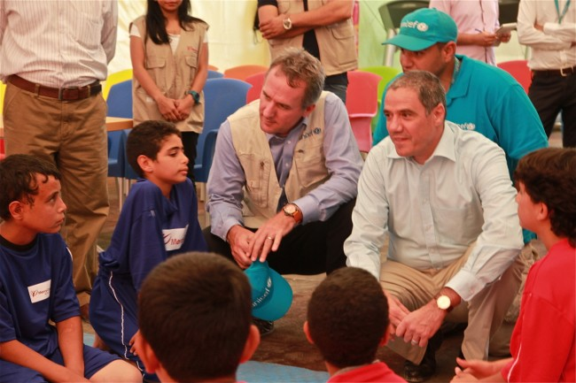 Mr Ralph Tarraf, German Ambassador to Jordan, and Robert Jenkins, UNICEF Representative in Jordan, talk to children.