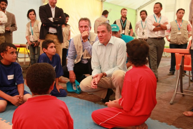 Mr Ralph Tarraf, German Ambassador to Jordan, and Robert Jenkins, UNICEF Representative in Jordan, talk to Syrian children in Za'atari Camp.