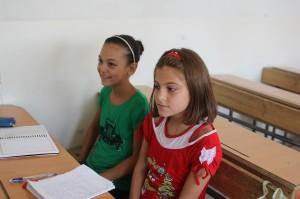 Lama (R), a fifth grader, attends the school club in Safi Al Dien Al Heli School three days a week. ©UNICEF/Syria-2014/Rashidi
