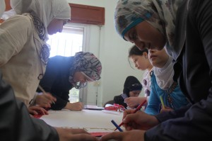 Children displaced by conflict work on a group art project at a UNICEF-supported adolescent friendly space in Tartous. © UNICEF/Syria-2014/Tiku